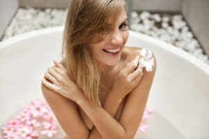 Women, wellness and beauty treatment concept. Pretty young woman with healthy soft skin, being naked